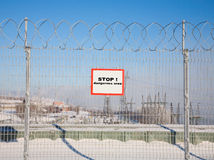 A fence of barbed wire Royalty Free Stock Photo