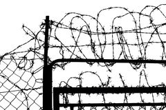 Fence with barbed wire. In b&w Stock Photo