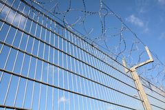 A fence with barbed wire Stock Photo