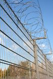 A fence with barbed wire Royalty Free Stock Images