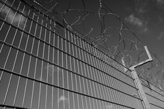 A fence with barbed wire Stock Photos