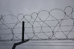 Fence with barbed wire. Airport Stock Photography