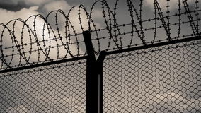 Fence with a barbed wire stock video footage