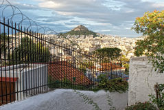 Fence with barbed wire on the background of Mount Lycabettus Royalty Free Stock Images