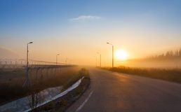 Fence with barbed wire on the border. Of the object at dawn with fog in the summer, russia Stock Image
