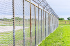 Fence with barbed wire. Do not enter, detention, prison Stock Images
