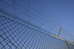 Fence with barbed wire. Day Royalty Free Stock Photo