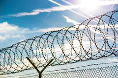 Fence with barbed wire Royalty Free Stock Photography