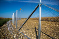 Fence and barbed wire install ready on the Hungarian - Croatian Stock Images