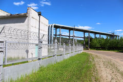 Fence with barbed wire. At the Krasnoyarsk power plant Stock Photos