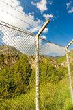 Fence with barbed wire in the open air.  Royalty Free Stock Photos