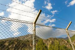 Fence with barbed wire in the open air.  Royalty Free Stock Images