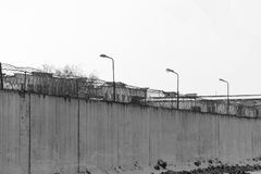 Fence with barbed wire, place of detention. Prison. Black and white photo royalty free stock image