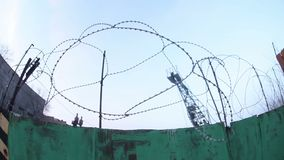 Fence barbed wire prison in the evening fisheye stock footage