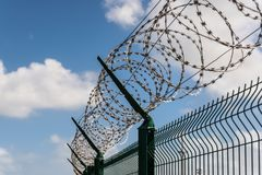 Fence with barbed wire. Protection fence with barbed wire stock image
