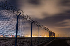 Fence with barbed wire, restricted area Stock Photos