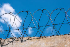 Fence with barbed wire. On the sky background Stock Photo