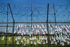 Fence with barbed wire and south korean flags at the demilitarised zone DMZ at the freedom bridge, South Korea, Asia Royalty Free Stock Photography