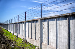 Fence with barbed wire Stock Image