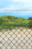 Fence with barbed wire. Stock Photography