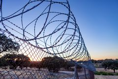 Fence with a barbed wire Royalty Free Stock Photos
