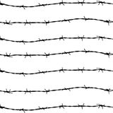 Fence from barbed wires Royalty Free Stock Images