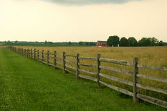 Fence and Barn. Fence, Barn, and Field of grain Stock Image