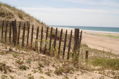 fence on beach Stock Photos