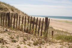 Fence on beach. Fence on edge of empty beach stock photos