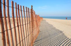 Fence on the beach Stock Images