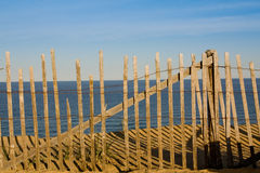 Fence on the beach Stock Photo