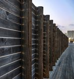 Fence on the beach from wooden boards with sun rays. Through them stock photography
