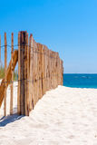 Fence on beach Royalty Free Stock Images
