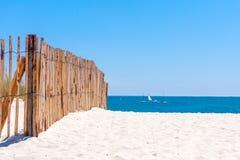 Fence on beach Royalty Free Stock Photos