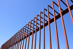 Fence with bent metal rods Stock Images