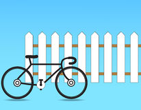 Fence. With a bicycle on a blue background Royalty Free Stock Photo