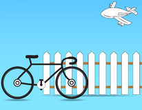 Fence. With a bicycle on a blue background Royalty Free Stock Photography
