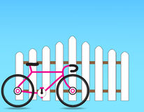 Fence. With a bicycle on a blue background Stock Image