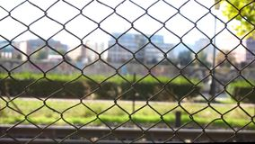 Urban fence in the wind. Fence blown by wind by urban railway stock footage