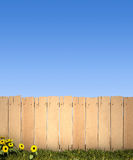 Fence and blue sky. 3D rendering of a wooden fence and a blue sky, ideal for inserting a message or image Royalty Free Stock Photo