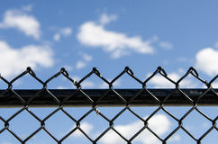 Fence and blue sky Royalty Free Stock Images