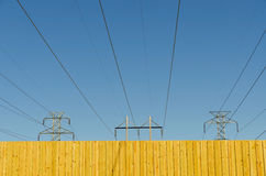 Fence with blue sky and power lines Stock Image
