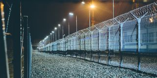 Fence boarder security. Night lights barrier zone area Royalty Free Stock Photos