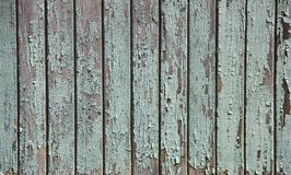 Fence of boards painted green in places worn royalty free stock photos