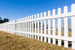 Fence Boundary Wood. Fence boundary three feet wood white structure across field stock image