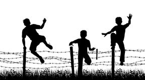 Fence boys. Editable vector silhouettes of three boys jumping over a barbed wire fence with boys, fence and grass as separate objects royalty free illustration