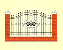 Fence with brick columns and metal bars Stock Photography