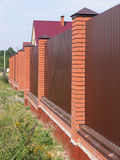 Fence with brick pillars Stock Photography