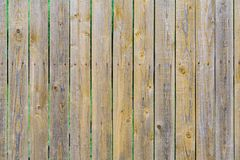 Fence of brown wooden boards planks background, texture. Fence of brown wooden boards planks as background, texture royalty free stock photo
