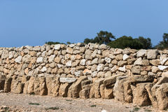 Fence built of natural stone Stock Images